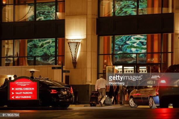 Visitors enter the Manchester Grand Hyatt Hotel in San Diego California US on Sunday Feb 11 2018 Hyatt Hotels Corp is scheduled to release earnings...