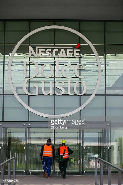 Visitors enter the Nescafe Dolce Gusto coffee factory operated by Nestle SA in Schwerin Germany on Thursday Oct 16 2014 The factory one of Nestle's...