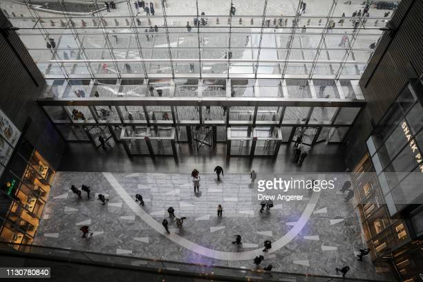 Visitors enter 'The Shops' during the grand opening of phase one of the Hudson Yards development on the West Side of Midtown Manhattan March 15 2019...