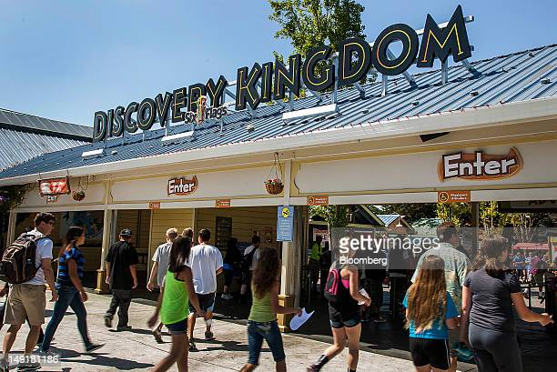 Visitors enter the Six Flags Discovery Kingdom amusement park in Vallejo California US on Monday July 2012 Six Flags Entertainment Corp an operator...