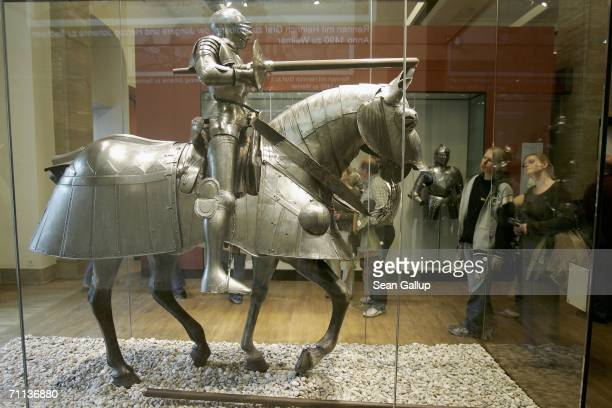 Visitors examine early 16thcentury armour for horse and rider at the German Historical Museum June 5 2006 in Berlin Germany The musuem called...