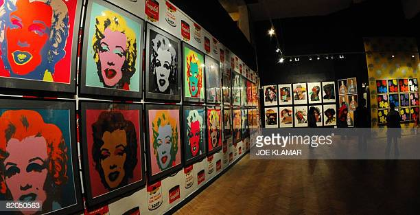 Visitors examine screen prints of pop art pioneer Andy Warhol at Andy Warhol's museum in eastern Slovak town of Medzilaborce on July 15 2008 The...