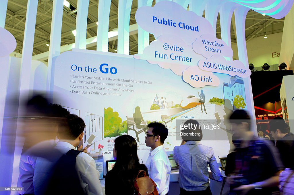 Visitors examine the cloud computing area in the Asustek Computer Inc. booth at Computex Taipei 2012 in Taipei, Taiwan, on Tuesday, June 5, 2012. Computex Taipei 2012 takes place from June 5 to June 9. Photographer: Ashley Pon/Bloomberg via Getty Images