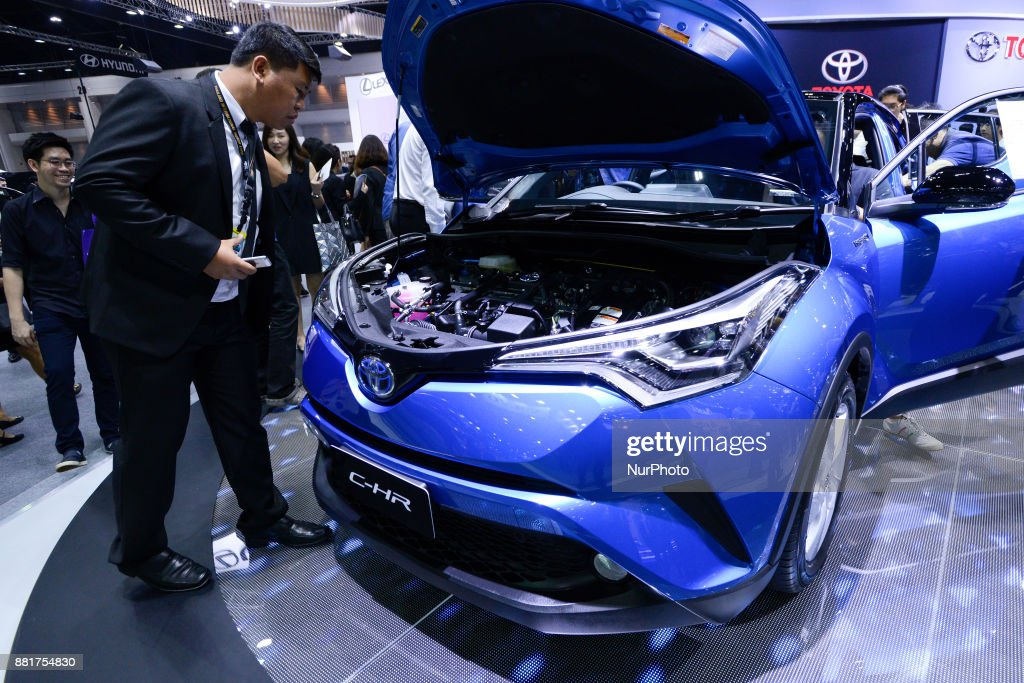Visitors examine the engine of Toyota C-HR during The 34th Thailand International Motor Expo 2017 at Muang Thong Thani in Bangkok, Thailand. 29 November 2017