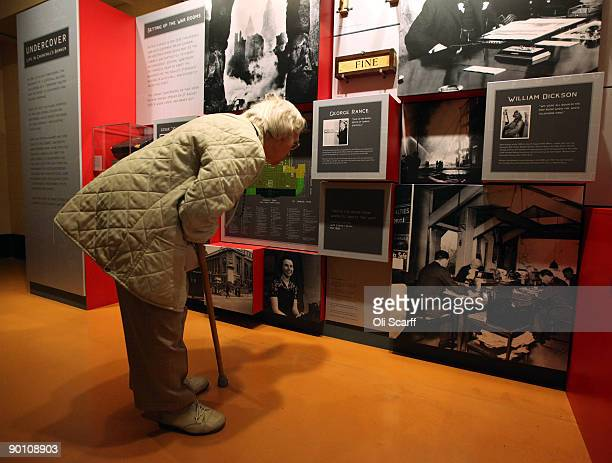 Visitors examine the new exhibition 'Undercover: Life In Churchill's Bunker' in the Cabinet War Rooms Museum on August 27, 2009 in London, England....