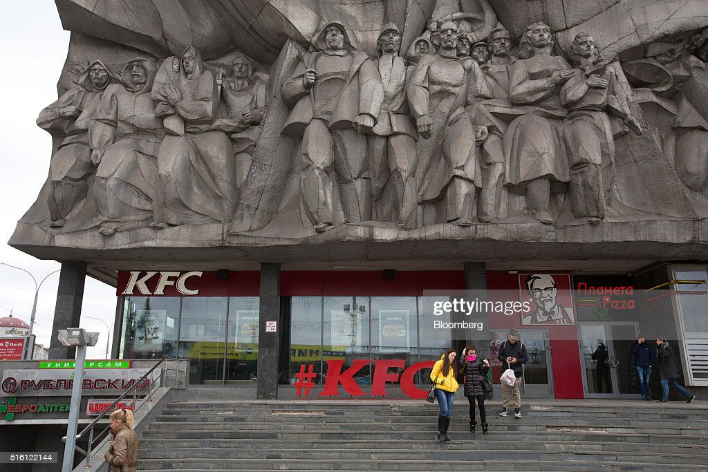 Visitors exit a Yum! Brands Inc. KFC fast food restaurant in the Belarusian fashion center in Minsk, Belarus, on Wednesday, March 16, 2016. European Union governments scrapped sanctions on leaders of Belarus in an effort to pry the former Soviet republic out of the shadow of the Kremlin. Photographer: Andrey Rudakov/Bloomberg via Getty Images