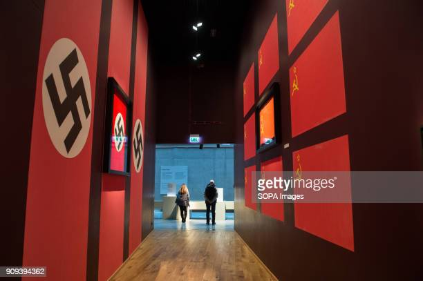Visitors exit an exhibit room with Nazi and Soviet flags at the World War 2 Museum The world war 2 museum in the Polish city of Gdansk was opened on...