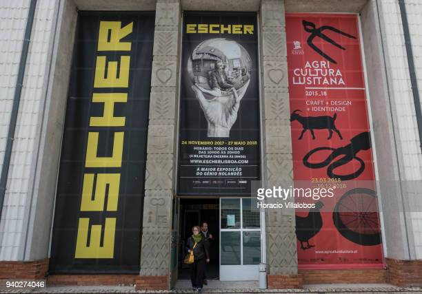 Visitors exit Dutch artist Maurits Cornelis Escher exhibition in Museu de Arte Popular on March 30 2018 in Lisbon Portugal This exhibition presents...