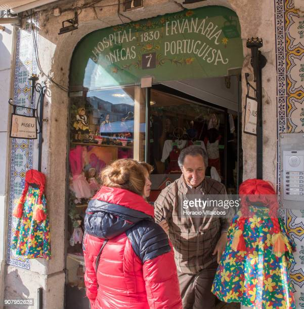 Visitors exit 'Hospital de Bonecas' in Praca da Figueira on January 18 2018 in Lisbon Portugal Started in 1830 by Dona Carlota an old lady making rag...