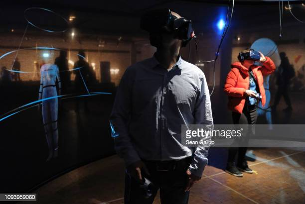 Visitors expereince a virtual reality installation called 'Das Totale Tanz Theater' at 'Bauhaus 100 Years The Opening Festival' '100 Jahre Bauhaus...