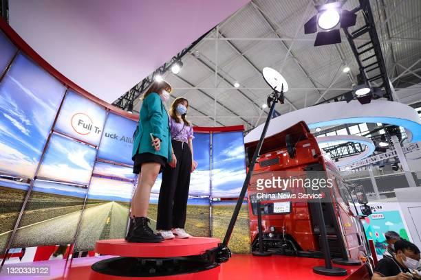 Visitors experience 360-degree panoramic video shot during the China International Big Data Industry Expo 2021 at Guiyang International Conference...