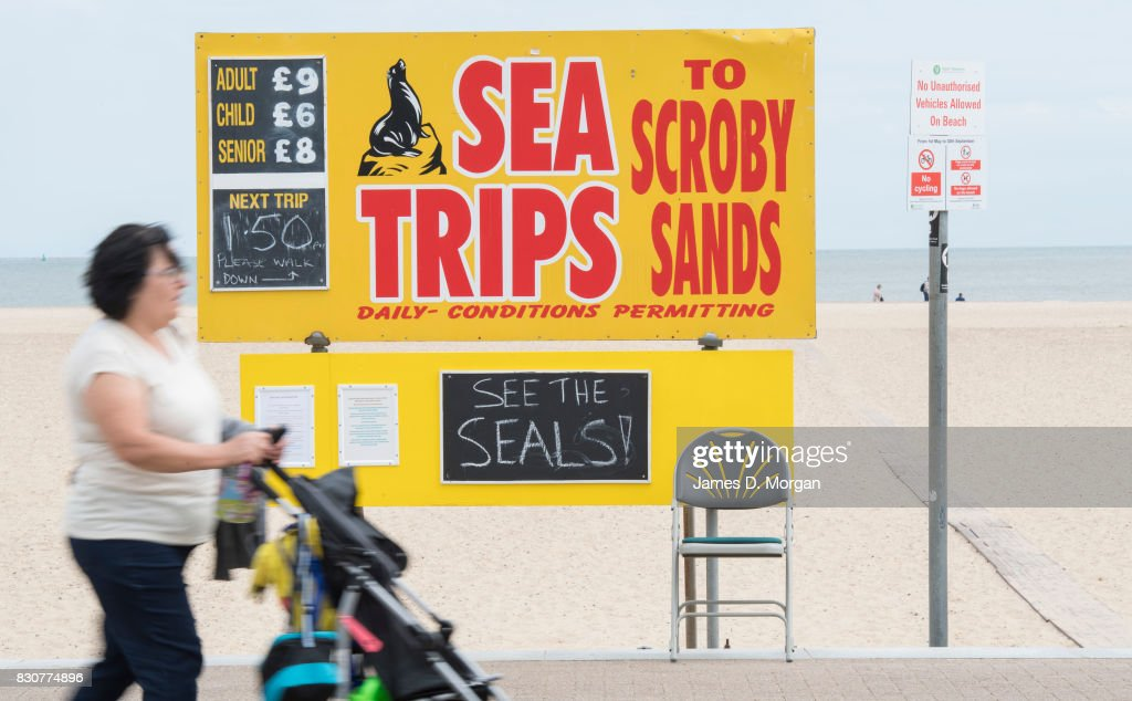 Visitors experience different food outlets on August 12, 2017 in Great Yarmouth, England. A cloudy overcast day greeted visitors to the Norfolk seaside town on one of the busiest weekends of the summer period. The town has been a seasiside resort since 1760 and today it has developed renewable energy sources with a wind farm of 30 generators within sight of the town in the North Sea. Thousands of British holidaymakers will visit the area over the summer period.