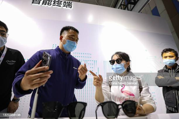 Visitors experience Huawei smart glasses during the China International Big Data Industry Expo 2021 at Guiyang International Conference and...