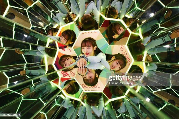 Visitors experience the interactive installation of video art at Van Gogh Star Art Exhibition in Hangzhou Zhejiang Province China December 26 2018