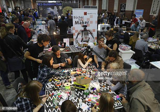 Visitors explore stands at the 2016 Berlin Maker Faire on October 1 2016 in Berlin Germany The Maker Faire combines a trade fair with handson...
