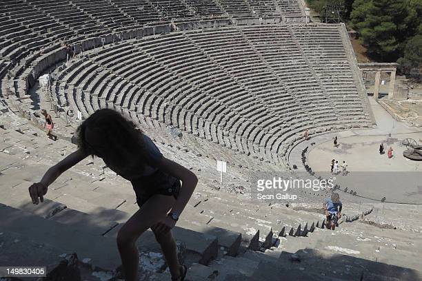 Visitors explore the former theatre at the ancient archeological site of Epidaurus on July 31 2012 in Epidaurus Greece Greece's many archeological...