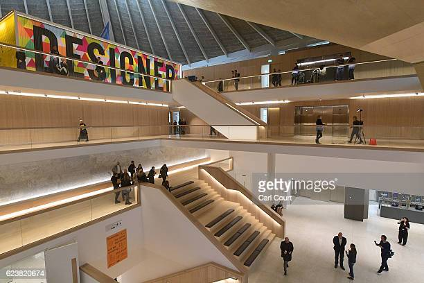 Visitors explore the new Design Museum during a media preview ahead of its official opening later this month, on November 17, 2016 in London,...