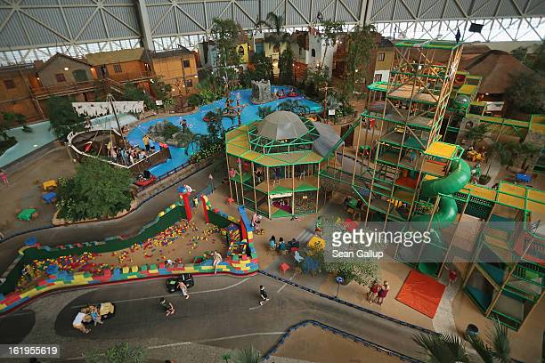 Visitors explore the Tropino children's adventure park at the Tropical Islands indoor resort on February 15 2013 in Krausnick Germany Located on the...