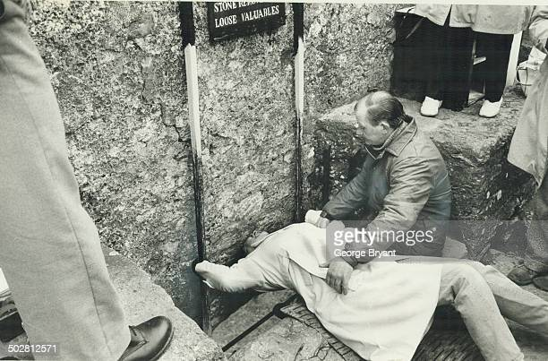 Visitors feel safer being held when they kiss the Blarney Stone eight storeys above the ground