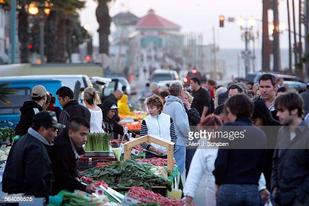Visitors fill Main Street in Huntington Beach for the city's Surf City Night's when a portion of the street is closed off to traffic The event held...