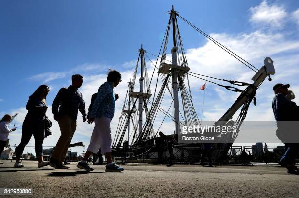 Visitors form a line to walk on board for a tour of the USS Constitution in the Charlestown neighborhood of Boston on Sep 2 2017 The Constitution...