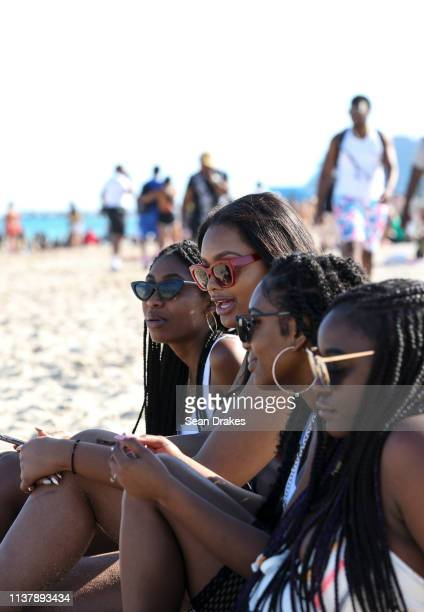 Visitors from Atlanta Georgia relax as thousands of college students and nonstudents attend Spring Break festivities in Miami Beach on March 23 2019...