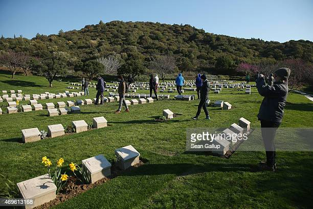 Visitors from Australia walk among graves of mostly Australian soldiers who died during the Gallipoli Campaign at Shrapnel Valley Cemetery near Anzac...