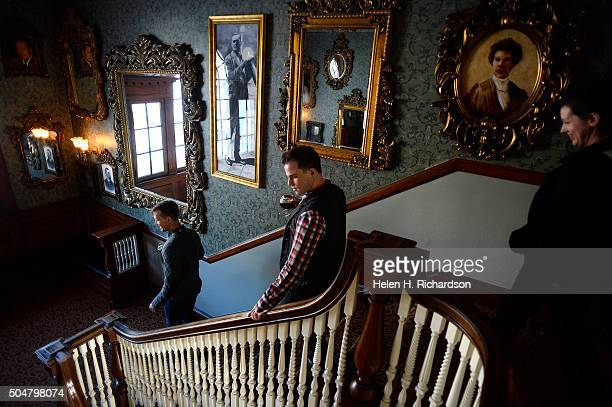 Visitors from left to right Landen Jones Joshua Potter middle and Elizabeth Myers right check out the array of old mirrors and pictures of previous...