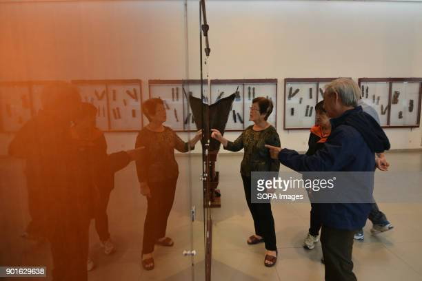 Visitors from Singapore looking at the Museum Collection 'TB Silalahi Center' in Balige The Lake Toba in the north of Sumatra as been formed during...