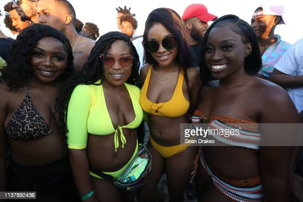 Visitors from Tallahassee Florida pose as thousands of college students and nonstudents attend Spring Break festivities in Miami Beach on March 23...
