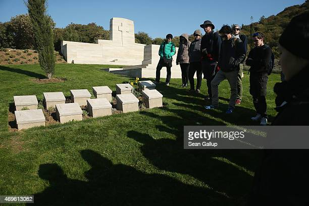 Visitors from the Clarence Valley region of Australia hold a moment of slience while standing at graves of mostly Australian soldiers who died during...