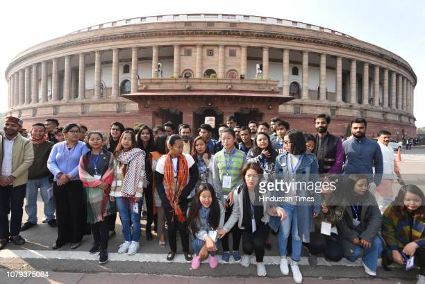 Visitors from the northeast pose for a picture during the winter session in Parliament on January 8 2019 in New Delhi India The last day of Lok...