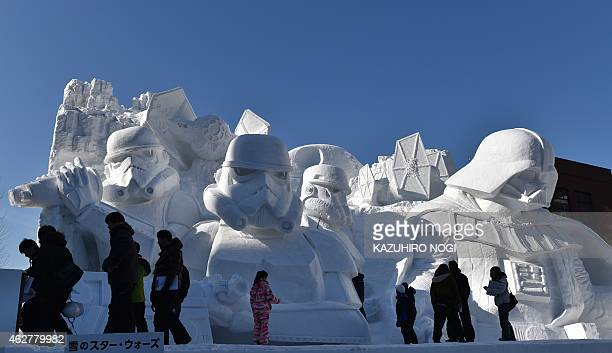 """Visitors gather around a large snow sculpture called the snow """"Star Wars"""" produced by the Japan Ground Self-Defense Force, Sapporo snow festival..."""