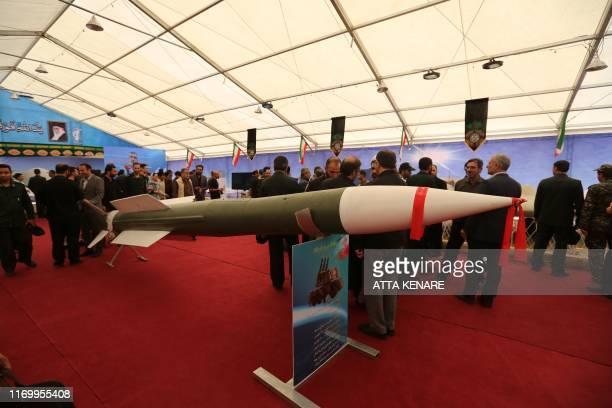 Visitors gather around a missile of the 3Khordad missile system at Tehran's Islamic Revolution and Holy Defence museum during the unveiling of an...