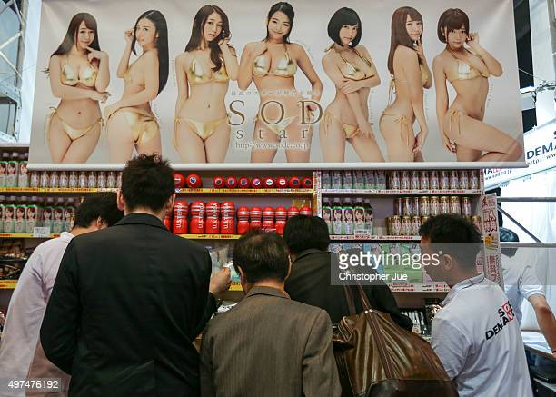 Visitors gather around adult goods at a booth during the Japan Adult Expo at the Toyosu PIT on November 17 2015 in Tokyo Japan At the Japan Adult...