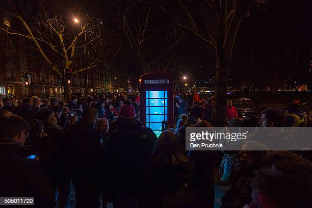 Visitors gather around Aquarium by artists Bufalino & Benoit Deseille is exhibited in Grosvenor Square during the Lumiere London exhibition on...