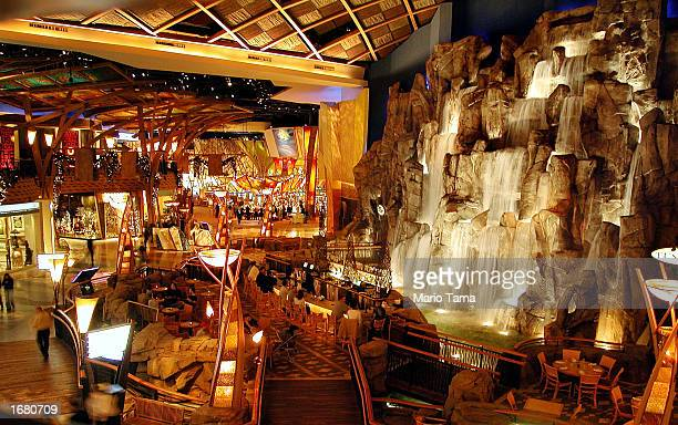 Visitors gather at a bar beneath a 55foot indoor waterfall at Mohegan Sun casino November 20 2002 in Uncasville Connecticut The casino is owned and...
