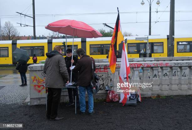 Visitors gather at Bernholmer Bridge, where on November 9 people first crossed unhindered from East Berlin into West Berlin following an unintended...