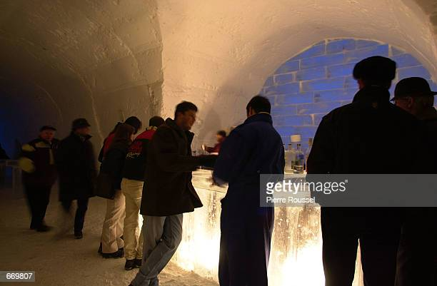 Visitors gather at the Absolut Ice Bar for an early night drink at the Absolut Ice Bar of the Ice Hotel QuebecCanada January 7 2001 in Quebec Canada...