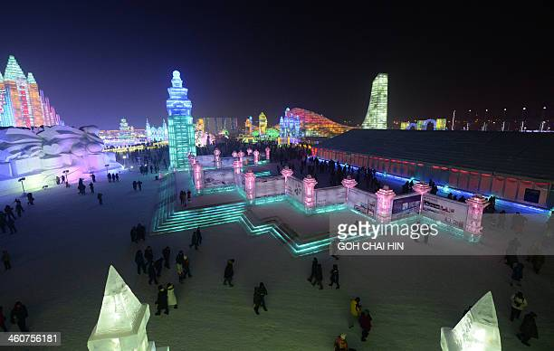 Visitors gather at the China Ice and Snow World after the official opening of the 15th Harbin International Ice and Snow Festival in Harbin in...