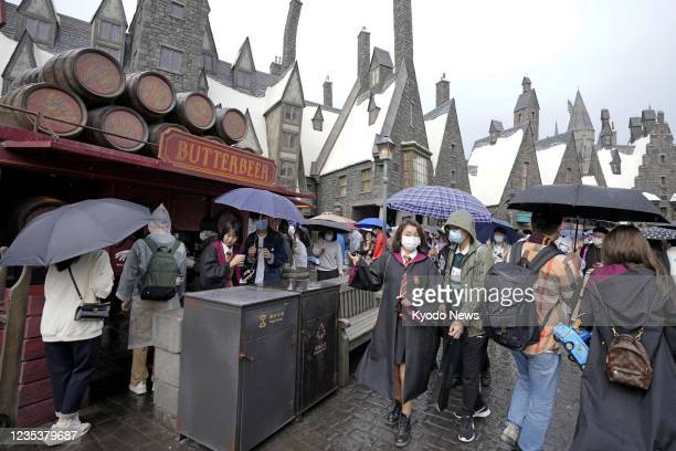 Visitors gather at the Harry Potter area of Universal Studios Beijing on the theme park's official opening day on Sept. 20, 2021.