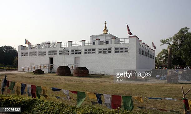 Visitors gather at the Maya Devi Temple in Lumbini some 200kms west of Kathmandu on April 17 2013 The temple is dedicated to Buddha's mother and is...