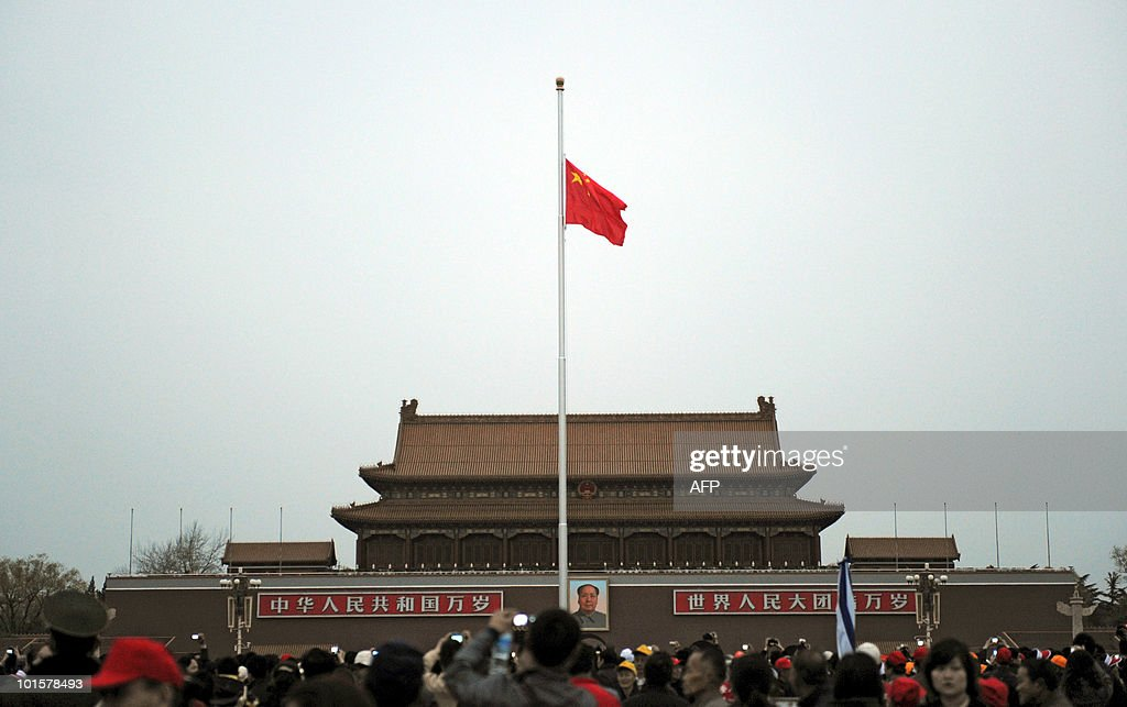 Visitors gather at Tiananmen Square in Beijing as the Chinese national flag is lowered to half-mast for the day of national mourning for victims of its killer quake on April 21, 2010. Top leaders and thousands of other people paid a silent tribute to the victims of the 6.9 magnitude earthquake which struck a remote area of northwestern China on April 14, 2010, leaving at least 2,064 people dead. AFP PHOTO/ Franko Lee
