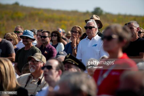 Visitors gather before US Vice President Mike Pence delivers a speech at the Flight 93 National Memorial on September 11 2019 in Shanksville...