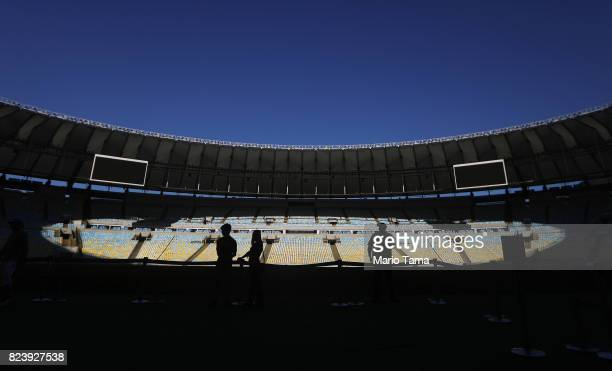 Visitors gather during a tour of Maracana stadium which hosted the opening and closing ceremonies of the Olympics on July 26 2017 in Rio de Janeiro...