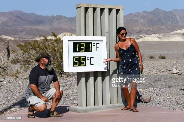 Visitors gather for a photo in front of an unofficial thermometer at Furnace Creek Visitor Center on August 17, 2020 in Death Valley National Park,...