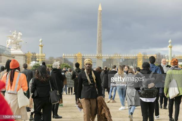 Visitors gather for the Christian Dior SE catwalk show during Paris Fashion Week at Tuileries Garden in Paris, France, on Tuesday, Feb. 25, 2020....