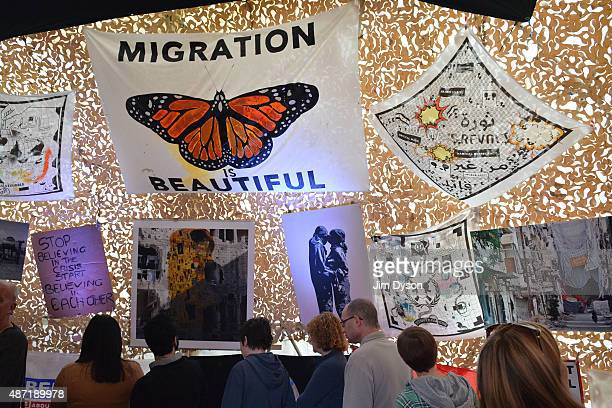 Visitors gather in a tent to view protest posters as Banksy's Dismaland Bemusement Park opens to the public on August 28 2015 in WestonSuperMare...