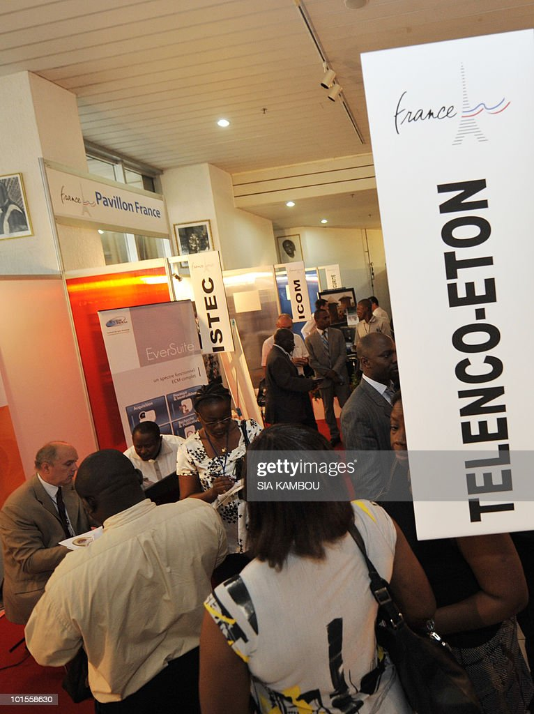 Visitors gather in front of a stall showcasing French products at the French pavillon during a trade show held in the framework of the 11th edition of the Technical and Communication Fair held at the Culture showroom in Abidjan on June02, 2010. AFP PHOTO SIA