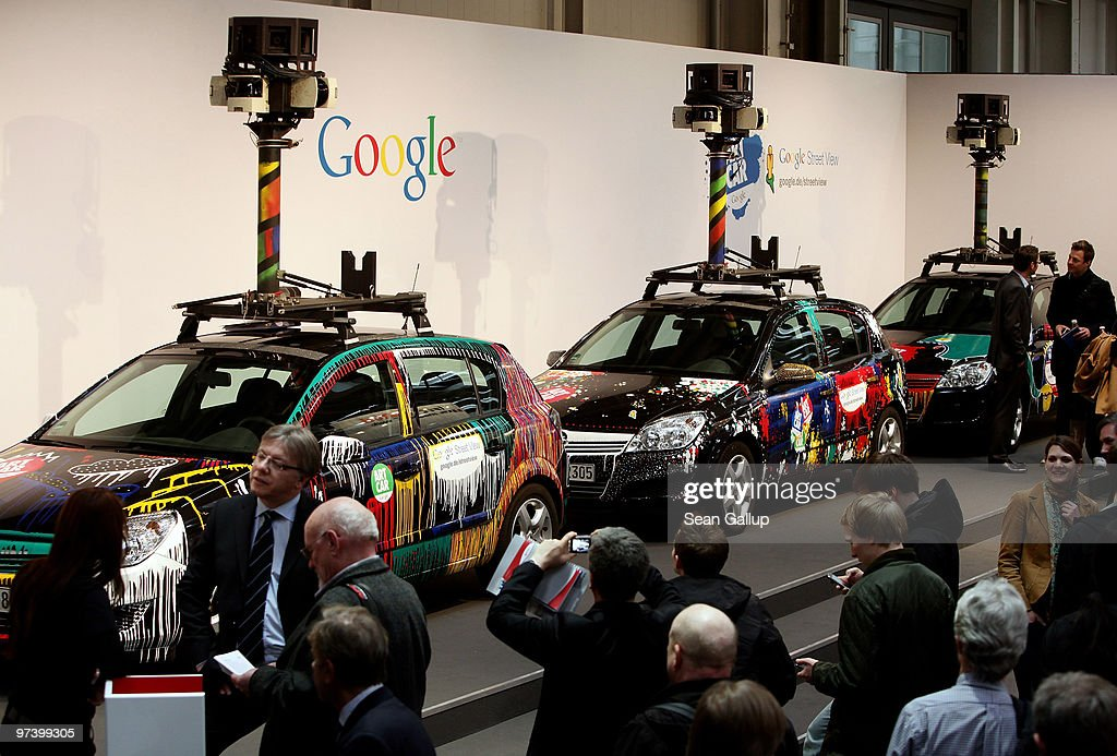 Visitors gather in front of German Google Street View cars at the Google stand at the CeBIT Technology Fair on March 3, 2010 in Hannover, Germany. Google's Street View project has raised controversy from people across Europe worried about infringement of their privacy. CeBIT will be open to the public from March 2 through March 6.